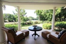 Main house guest bedroom terrace with garden and golf course views