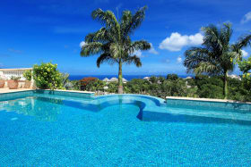 Solar heated infinity swimming pool with sea
