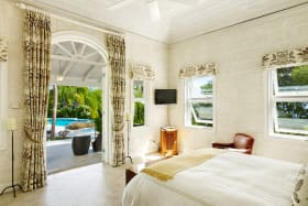 Ground floor bedroom opens to a balcony and swimming pool