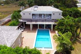 Aerial view of the home and swimming pool
