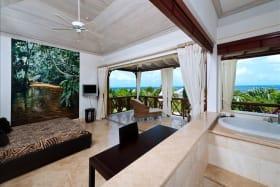 Master bathroom open to bedroom, balcony and sea views