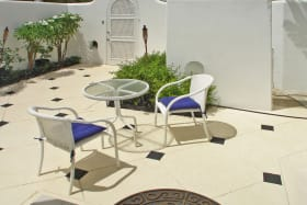 Casual dining in the courtyard ideally adjacent to the kitchen