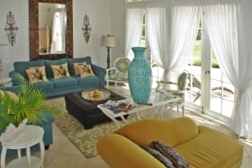 Elegantly furnished living room with french doors to the patio