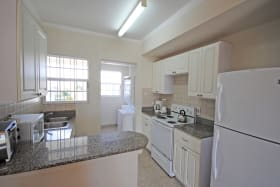 Well equipped kitchen and laundry opens to covered patio
