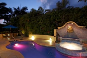 Beautifully lit swimming pool and jacuzzi