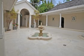 Open courtyard and view of front entrance to house