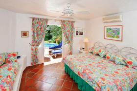 Ground floor bedroom suite opens to pool terrace