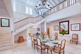 Dining room and impressive stairway upstairs