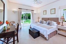 En suite guest bedroom opens to veranda and garden
