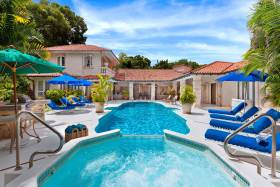 Swimming pool and jacuzzi adjoining verandas and sun terrace