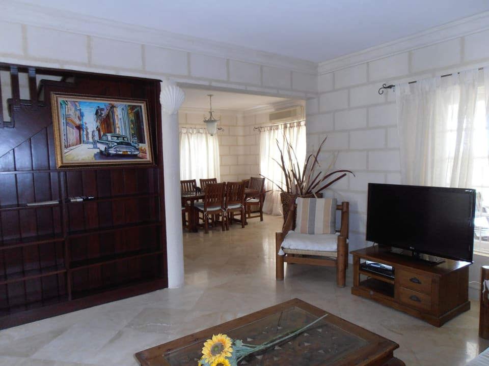 Living room with dining room in background