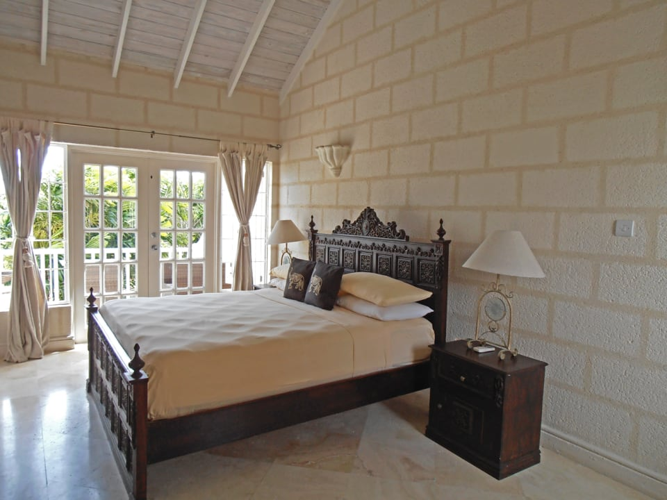 Master bedroom showing small patio