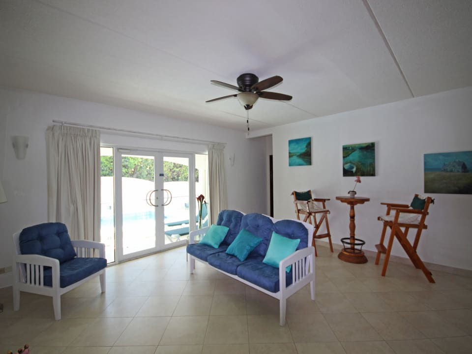 Spacious Living room opening onto the patio and pool deck