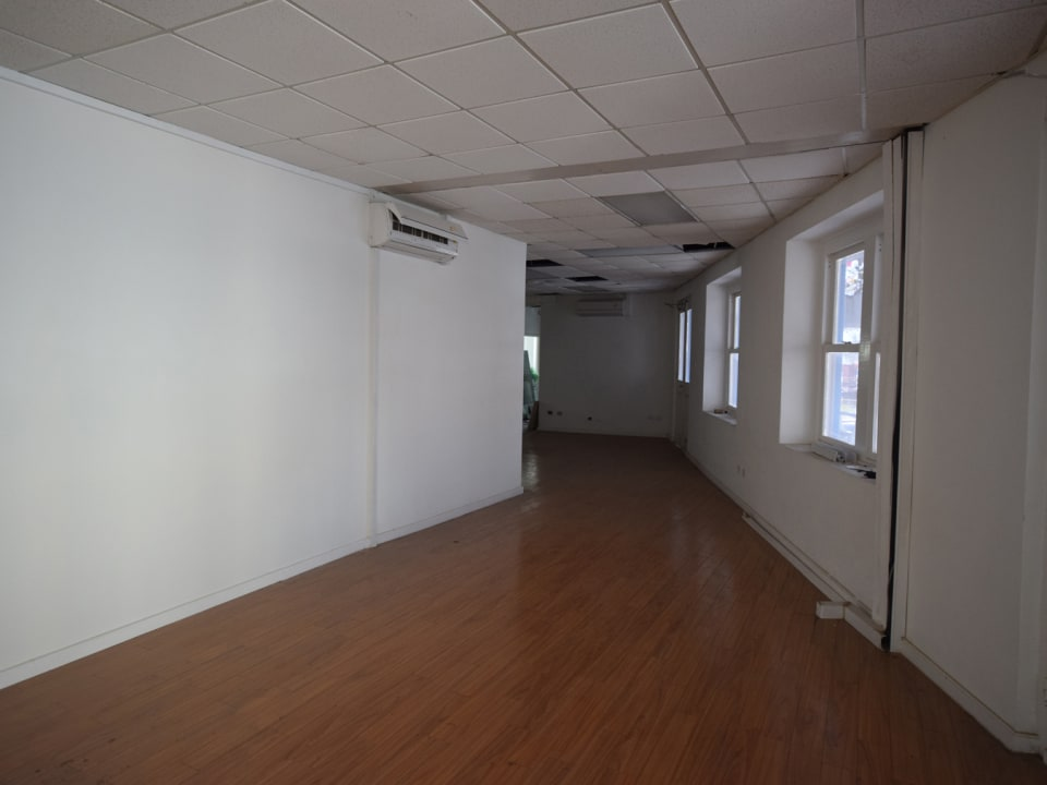 Upstairs space with hardwood floors
