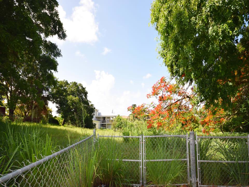 Fenced lot entrance