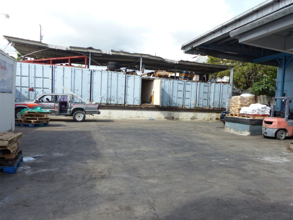 Storage for 7 containers by warehouse loading bay