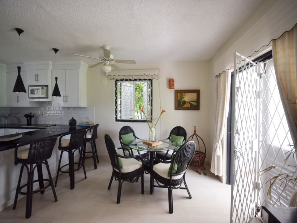 Dining area with open plan to kitchen