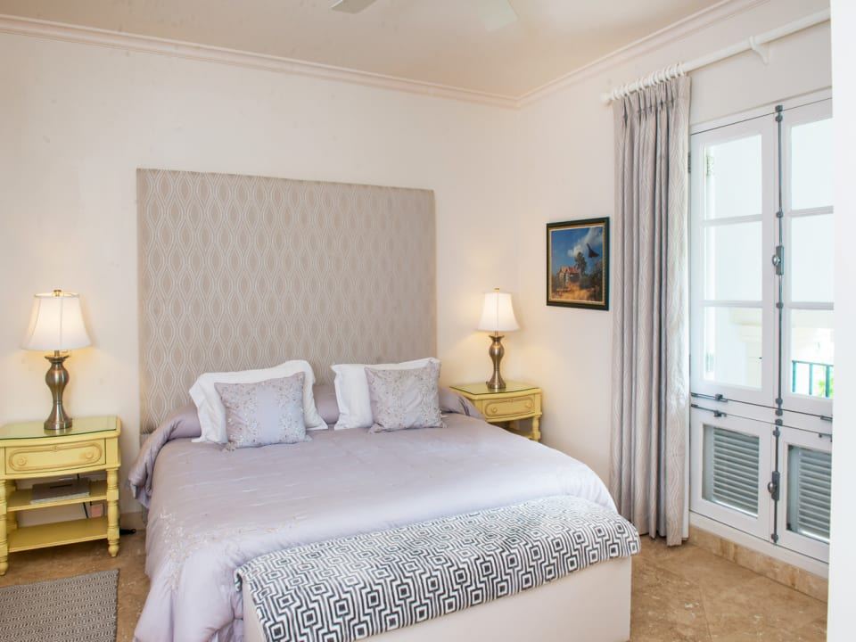 Second en suite bedroom opens to a balcony with sea views