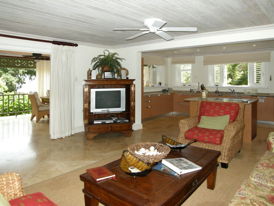 Indoor living room that opens to the covered patio