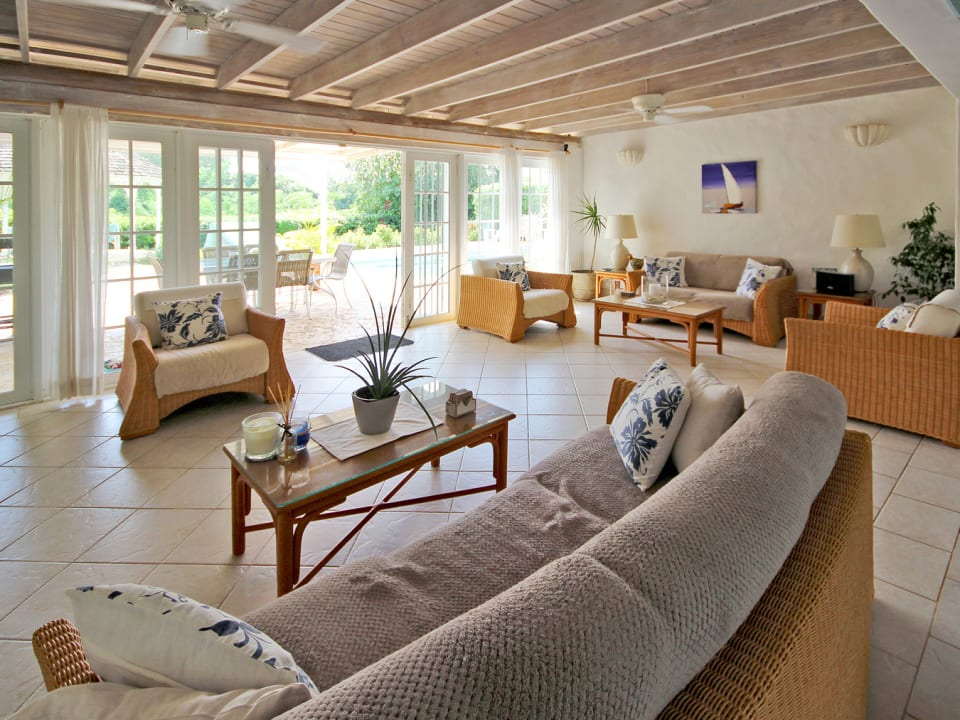Open plan living room with access to pool deck