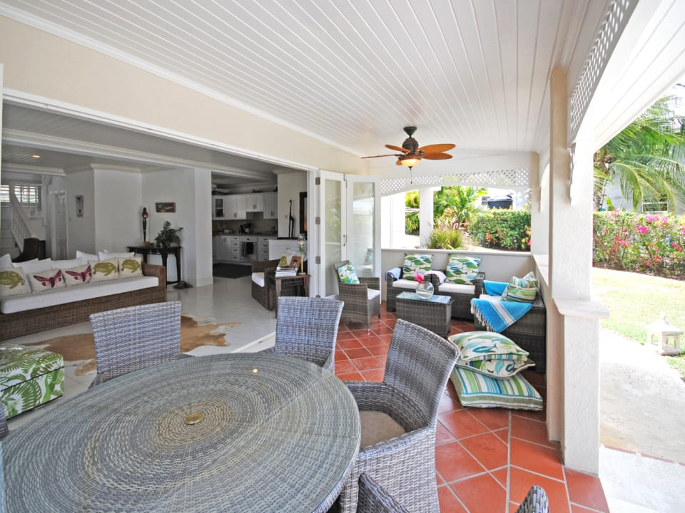 Covered veranda leads to the swimming pool terrace