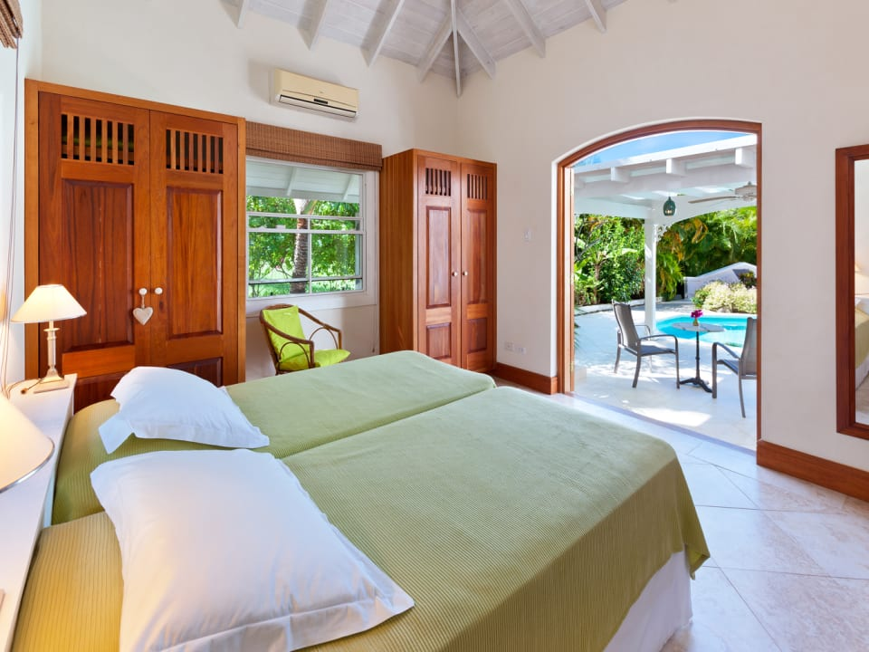 Guest bedroom on ground floor opens to pool terrace
