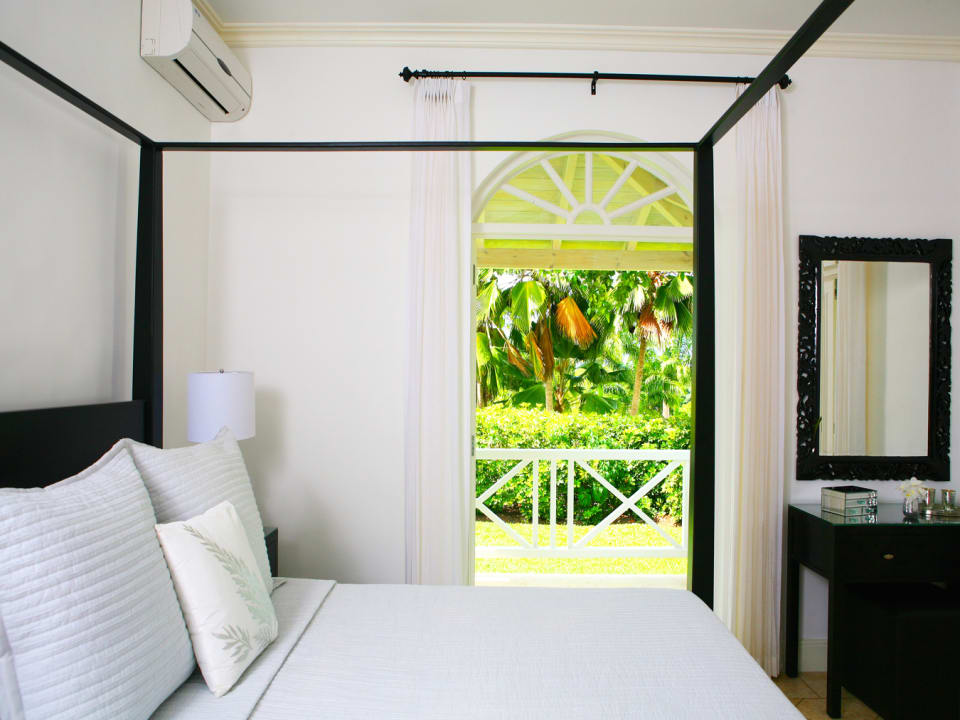 Another guest bedroom opens to a balcony and garden views