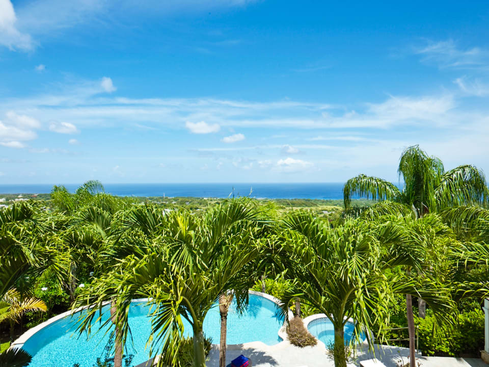 Stunning views of the pool, garden and ocean beyond