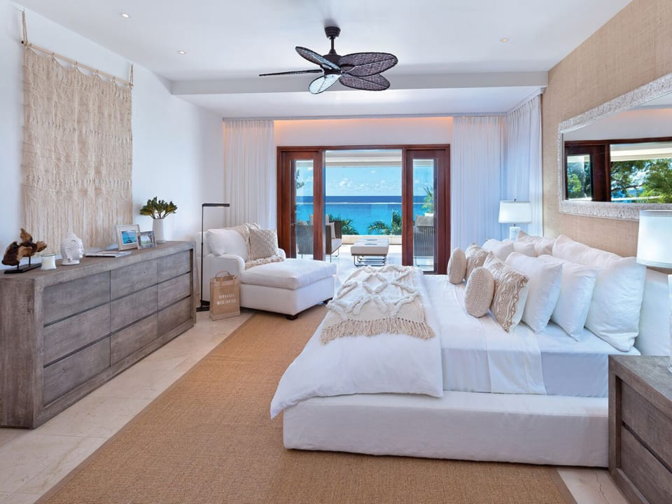 Spacious master bedroom with a private outside terrace with ocean views
