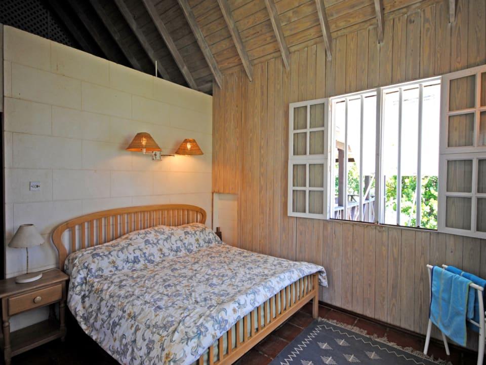 Master bedroom on upper floor has an ensuite bathroom