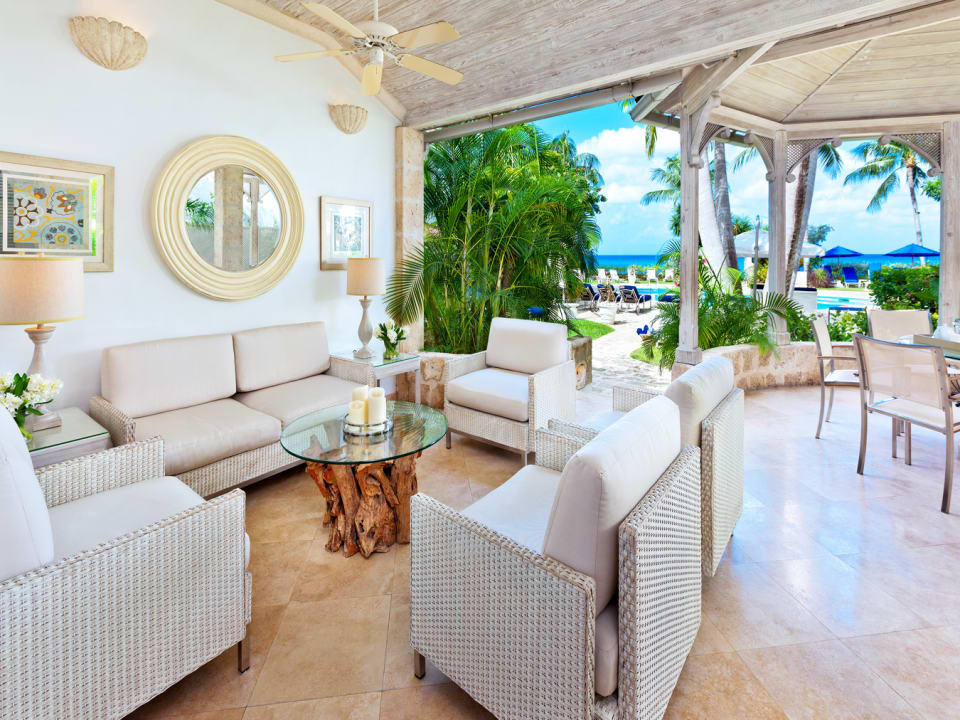 Terrace with private dining gazebo and easy access to pool and beach