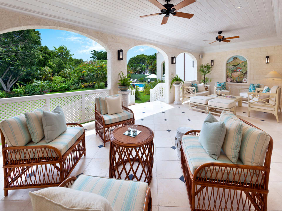 Expansive terrace leads to garden and pool
