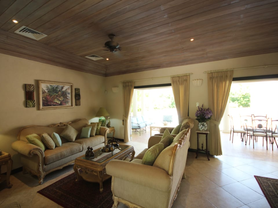 Living room opening to the pool and deck