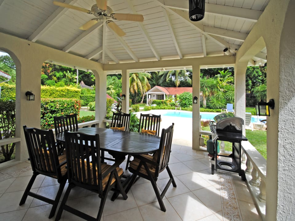 Dining terrace overlooks the pool
