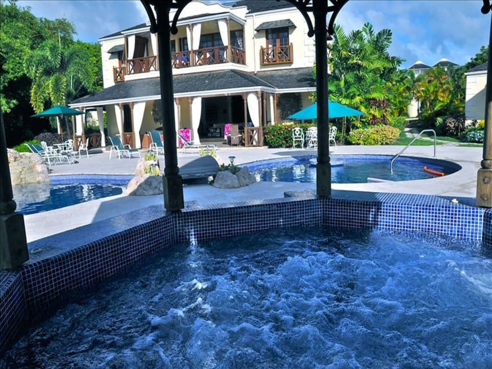 View of main swimming pool from the jacuzzi