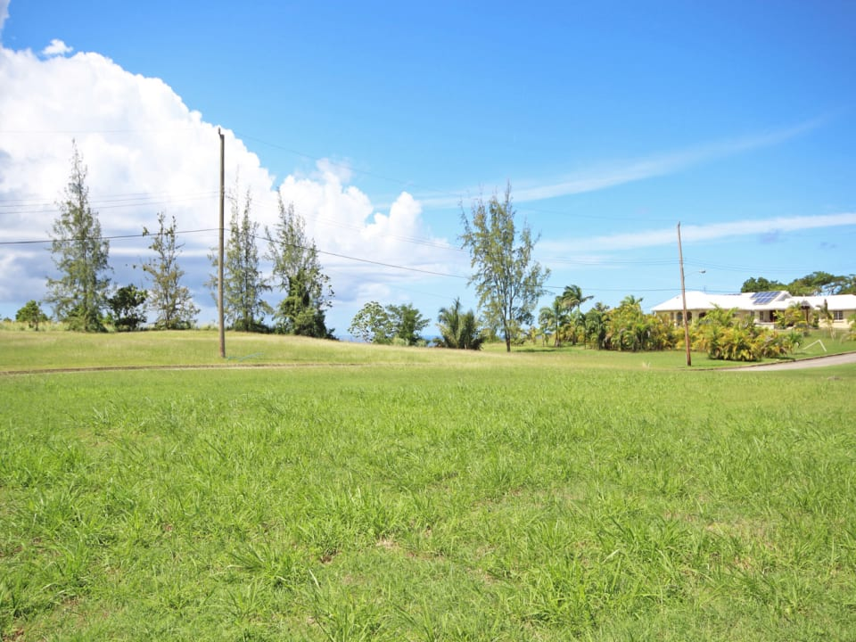 Rectangular lot with potential for sea views with a 2 storey structure