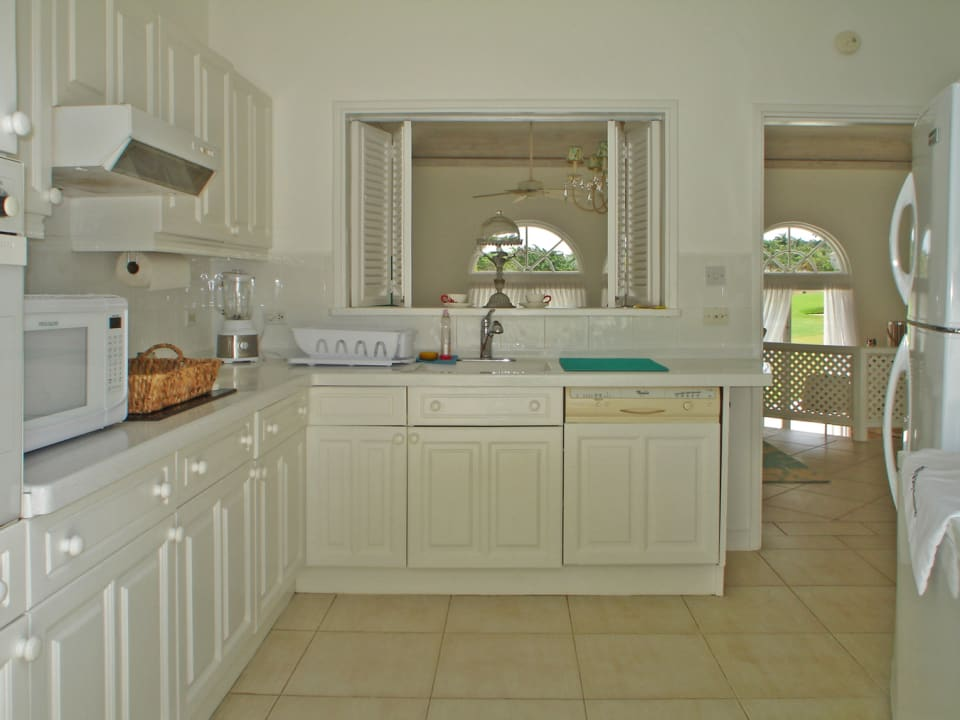 Well equipped kitchen opening to the formal dining area