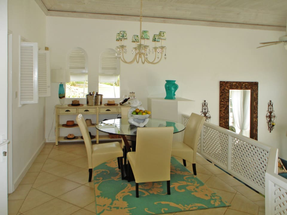Formal dining area overlooking the living room and the views