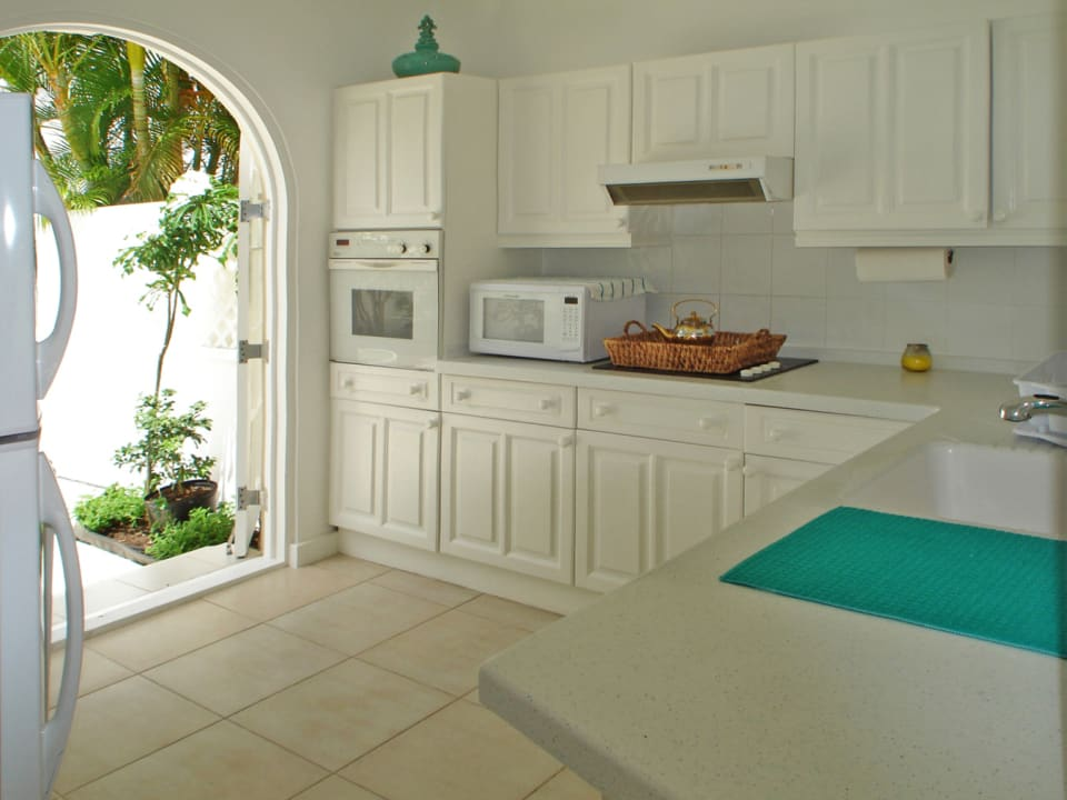 Kitchen opening to courtyard