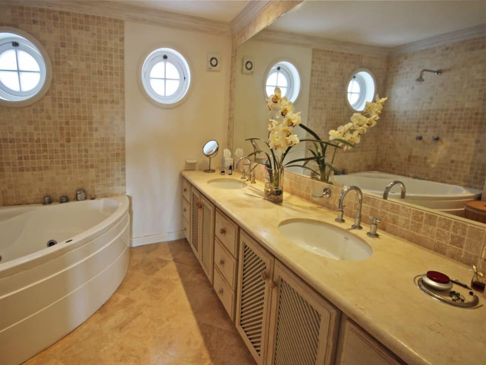 Master bathroom with jacuzzi and double vanity