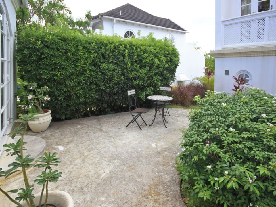 Outdoor patio between cottage and main townhouse