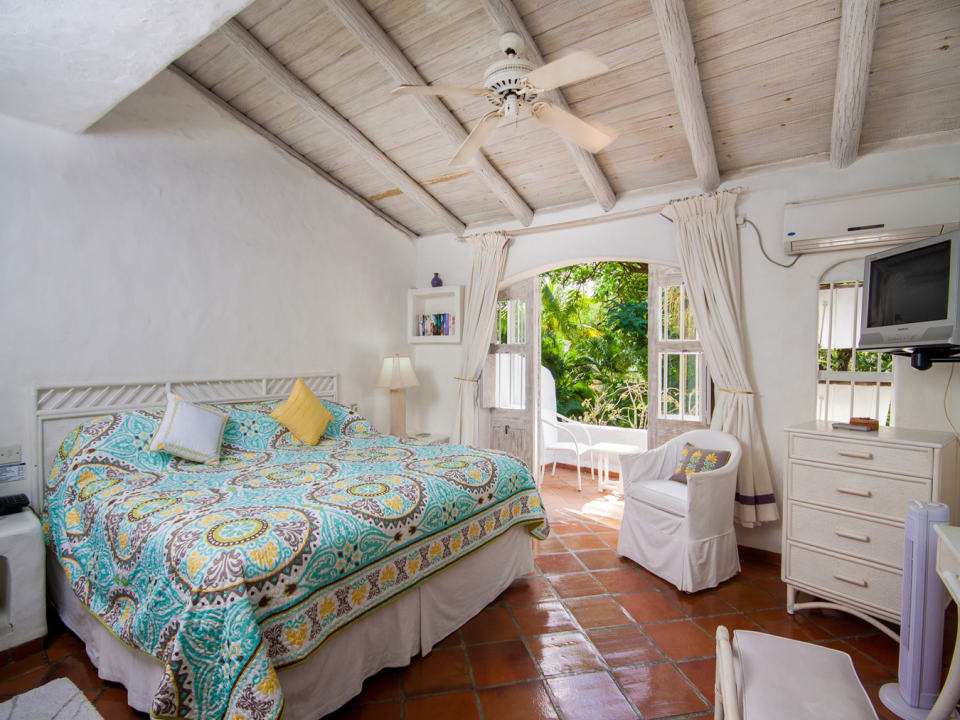 Master bedroom opens to private balcony