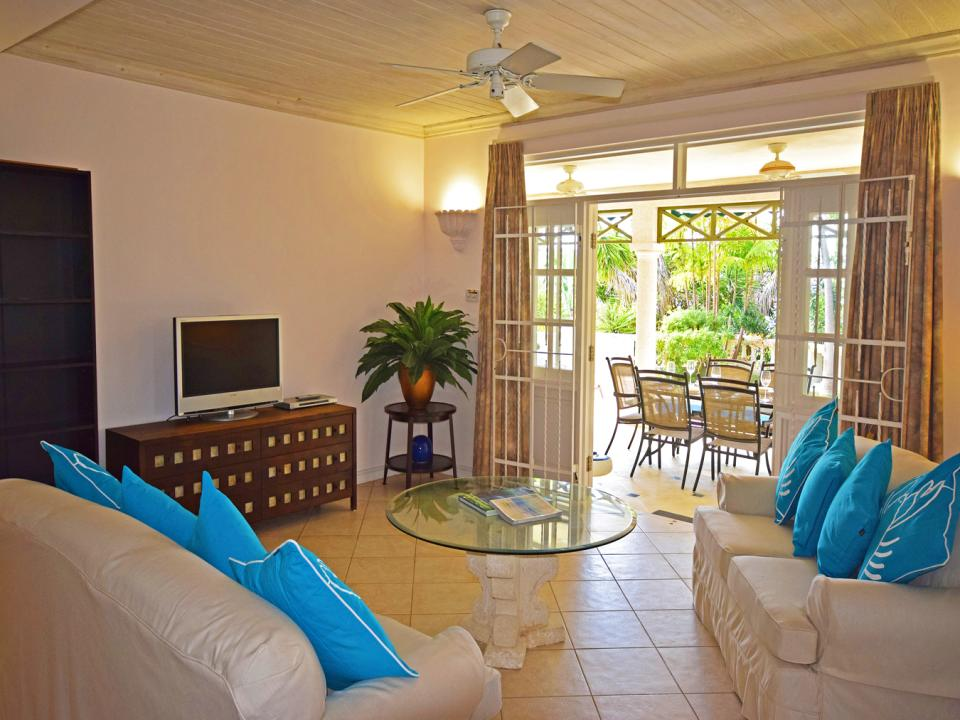 Living room opens to covered verandah