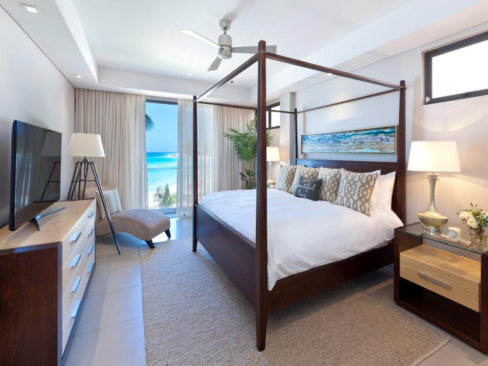 Master bedroom with beautiful beach and sea views
