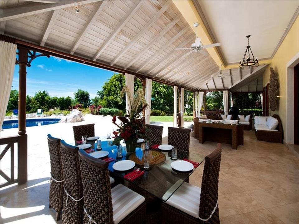Dining terrace and lounge open to swimming pool deck