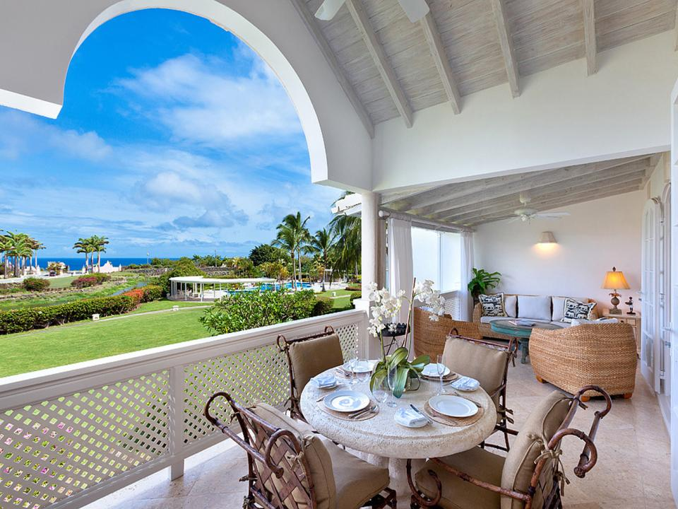 Partially covered patio with sea views