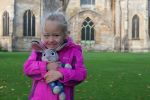 Ellie Posing outside Tewkesbury Abbey for 50mm Natural light project