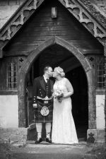 Black and White photograph of Bride and Groom leaving the church