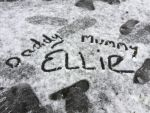 Family writes names in the snow
