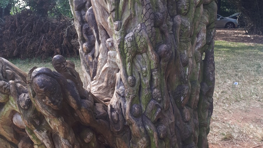 A story telling carved tree in Aburi Botanical Gardens